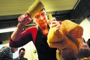 Jasmine Wilson hard at work on her latest carving. Picture: OX72097 Richard Cave