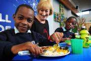 Headteacher Lisa Rowe with Lewis, left, eating chilli con carne, and Sebastian Heudi, eating chicken noodles he brought in from home Picture