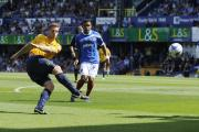 Johnny Mullins fires in a shot in United's 4-1 win at Portsmouth on the opening day of last season