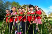 Forest school co-ordinator Ysella Wood, centre, with Cutteslowe Primary School pupils inside the willow dome