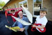 Children's author Korky Paul celebrates the opening of the new classrooms with pupils Robert Challis, eight, and Sameeya Khan, eight