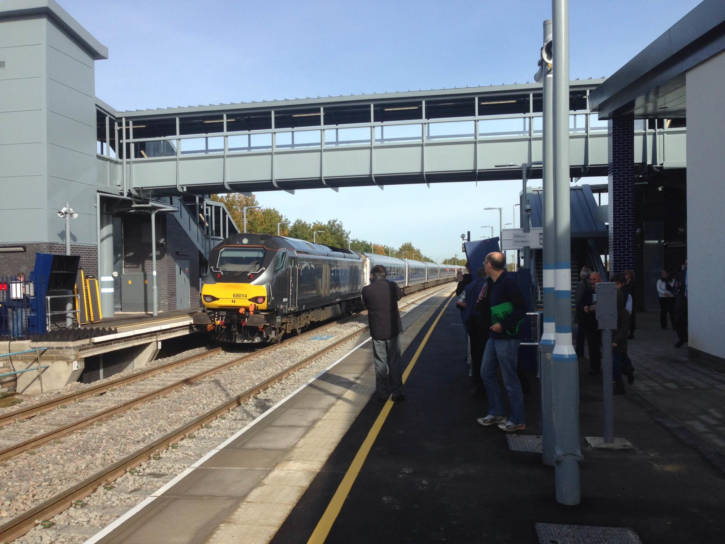 Keen passengers board the first trains to leave Oxford Parkway