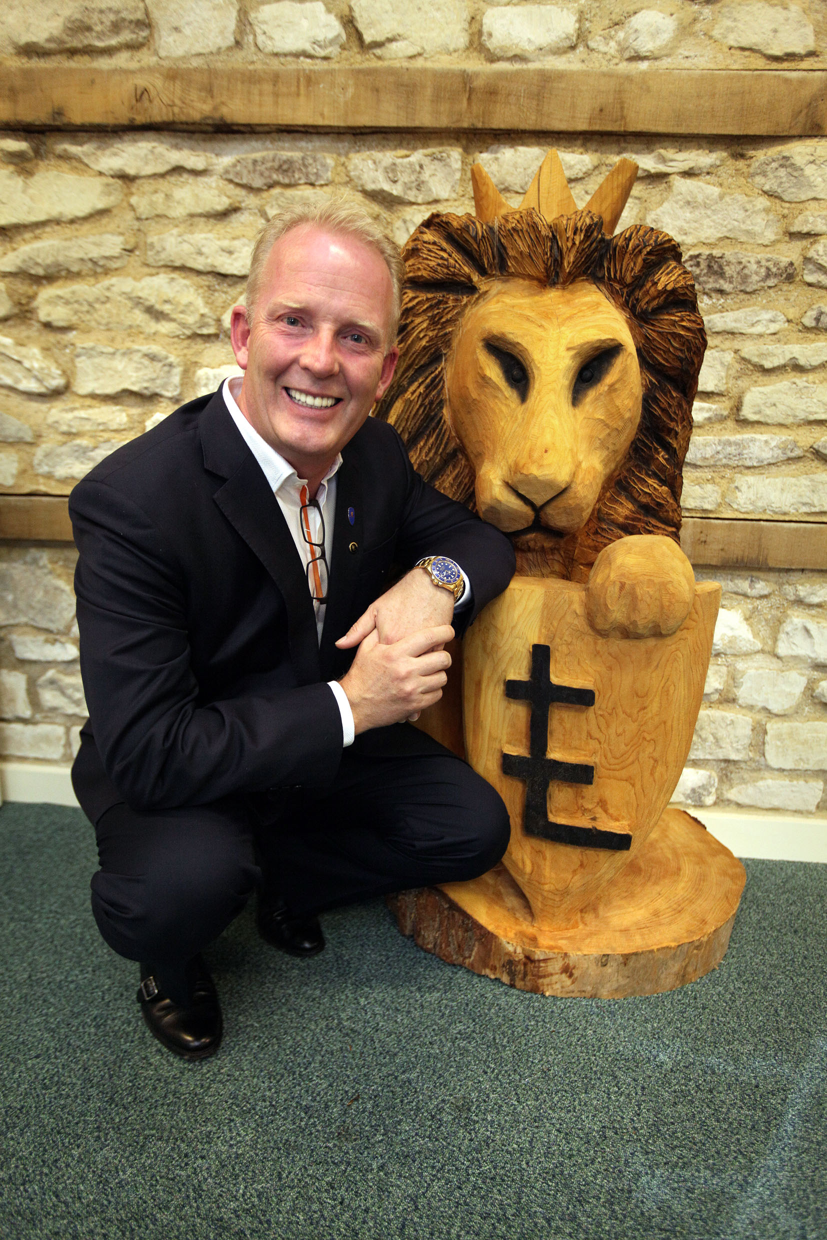 Roaring success: LEO co-founder Dan Andersson with a wooden lion carving used as the company's symbol