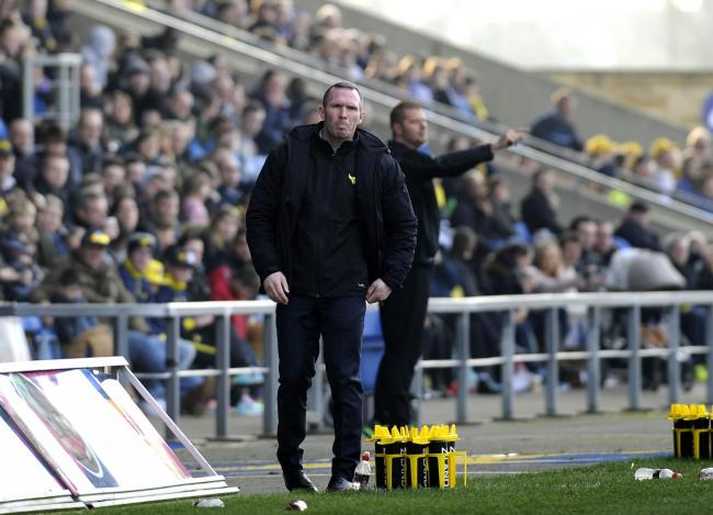 A grim-faced Michael Appleton watches United's defeat by Orient