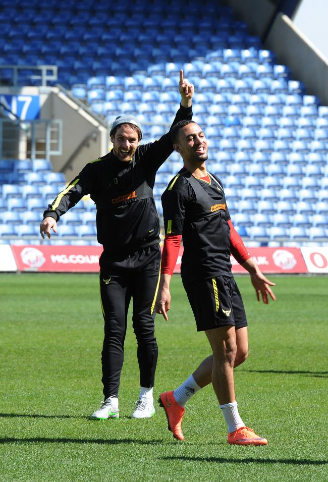Danny Hylton is relishing the biggest game of his career against Wycombe Wanderers today, but says the Oxford United players are in a relaxed mood. Judging by this light-hearted moment in training on Thursday, where Hylton jokes with Kemar Roofe, he is ri