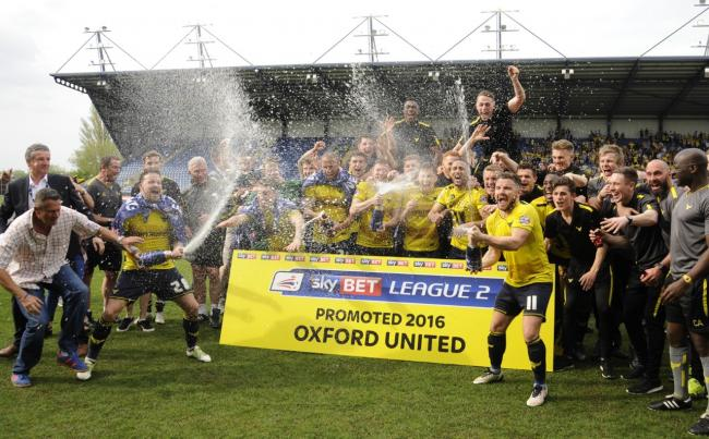 Oxford United celebrate promotion on the pitch  Picture: David Fleming