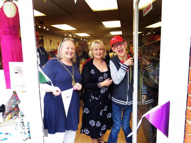 Mayor of Wallingford Ros Lester reopened the town's Style Acre charity shop after a refurbishment on Saturday, June 4, 2016. She is pictured with work manager Michelle Staniforth and Adam Starling who has been supported by the charity.