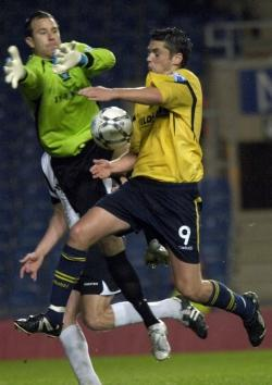 The Salisbury keeper bundles over Duffy to give the U's a penalty