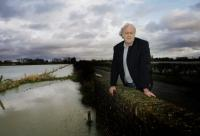 Witney Gazette: Farmer John Hook with flooded fields at Cote, near Bampton