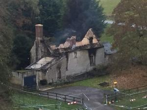 Witney Gazette: An elderly couple are feared dead after fire destroyed a cottage on the Blenheim Estate