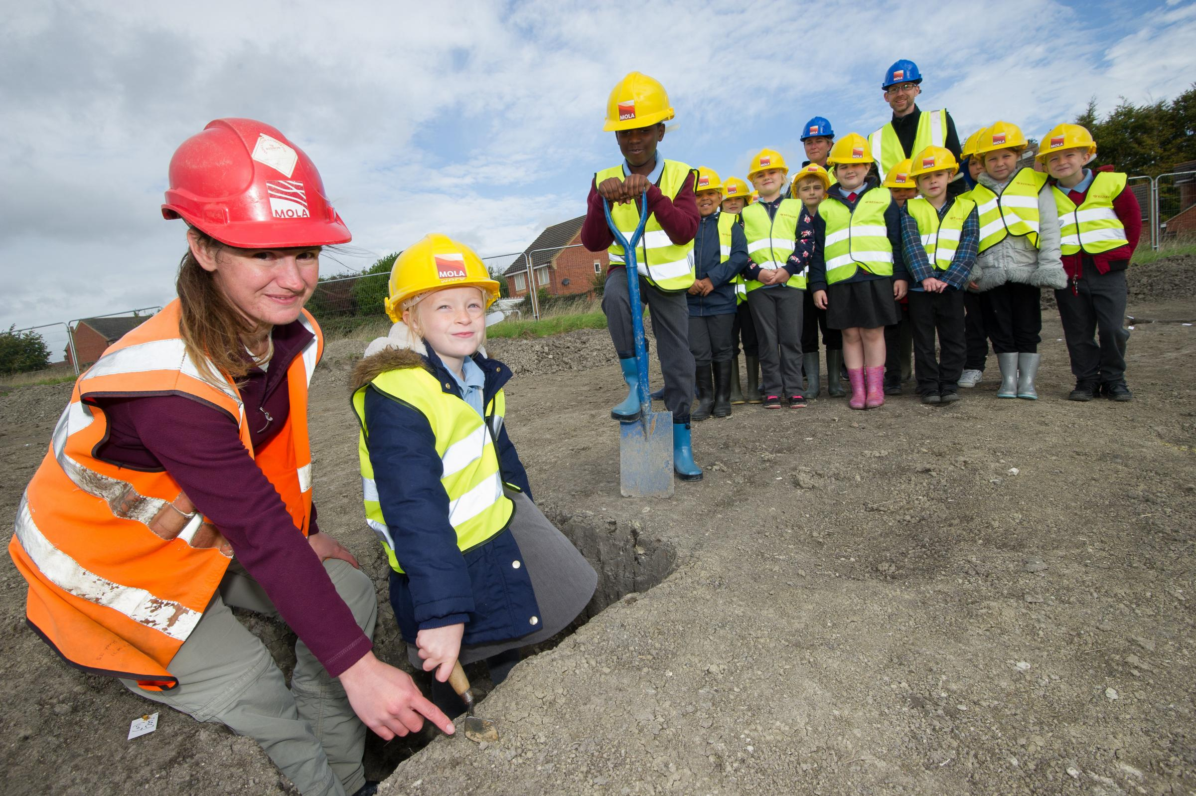 Pupils from St Blaise school in Didcot help Susan Porter dig for finds as they look around the site near them where Redrow Homes are going to build a new development - Matthew Power