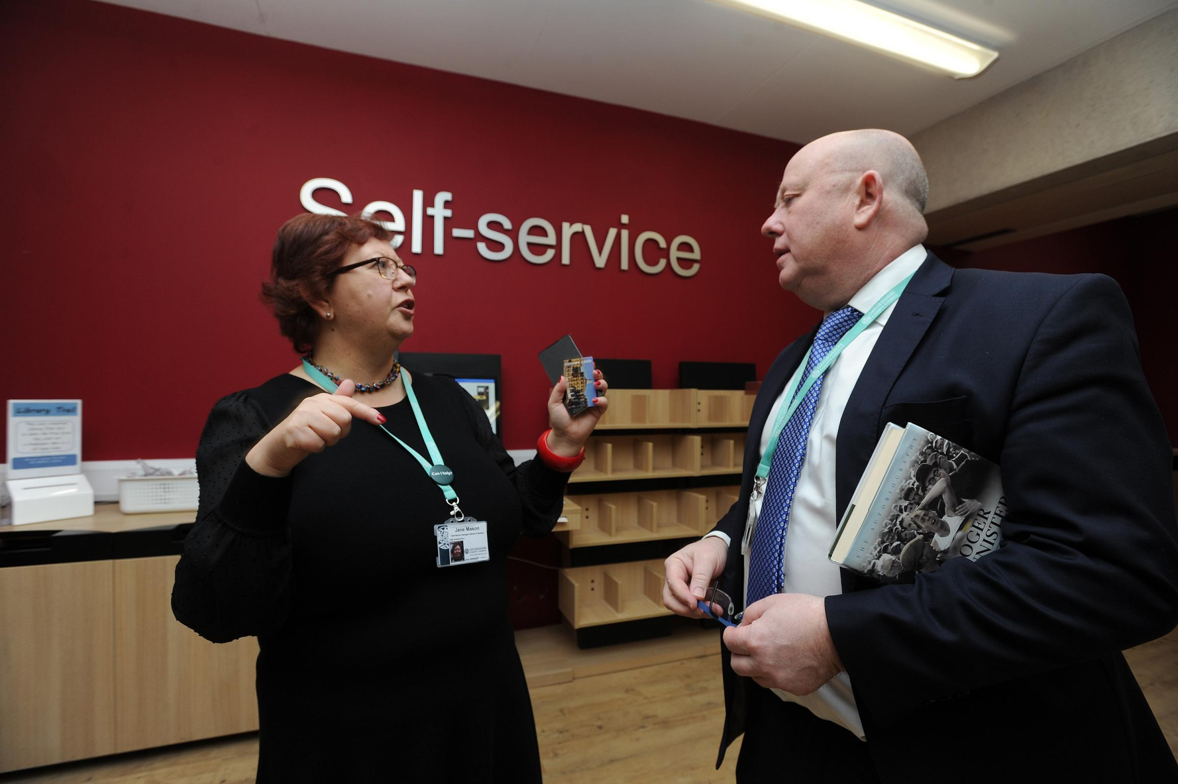 Oxfordshire County Council leader Ian Hudspeth chats with one of his council's employees – Oxford Central Library manager Jane Mason. Picture: Jon Lewis