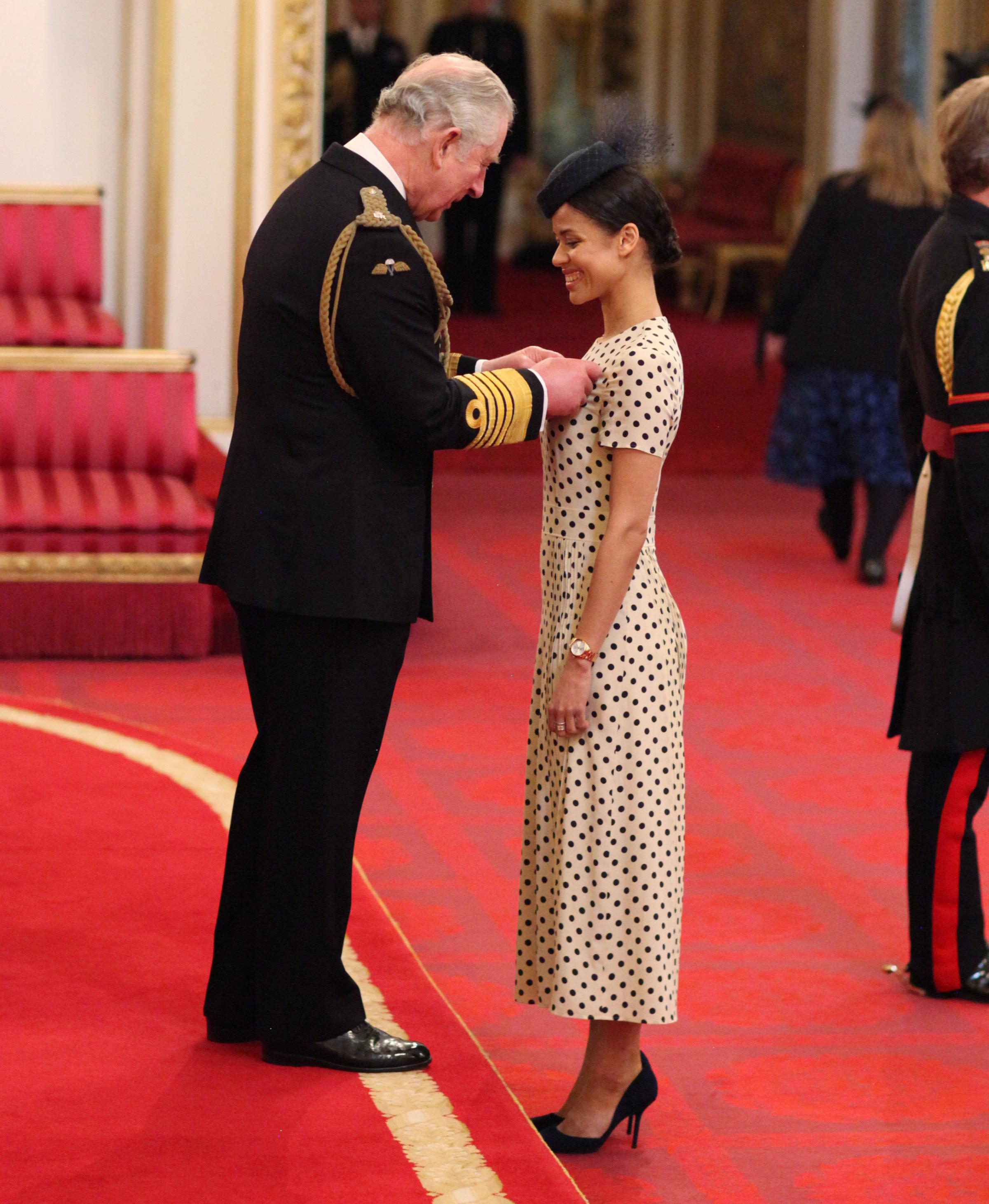 Gugulethu Mbatha-Raw from Witney is made an MBE (Member of the Order of the British Empire) by Prince of Wales, during an Investiture ceremony at Buckingham Palace. Picture: PA
