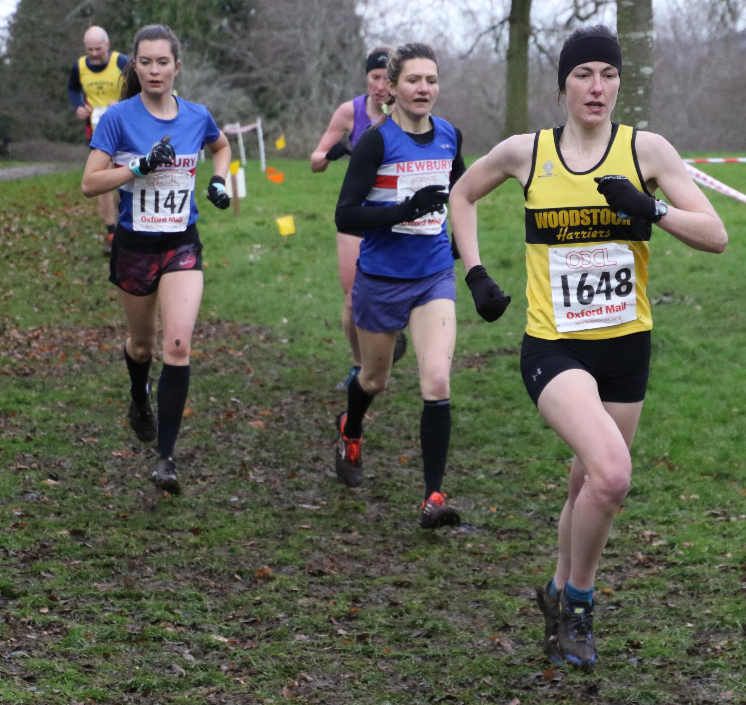 PACE: Woodstock Harrier Jessica Webb leads Newbury's Jessica Franklin and Isobel Fry Picture: Barry Cornelius
