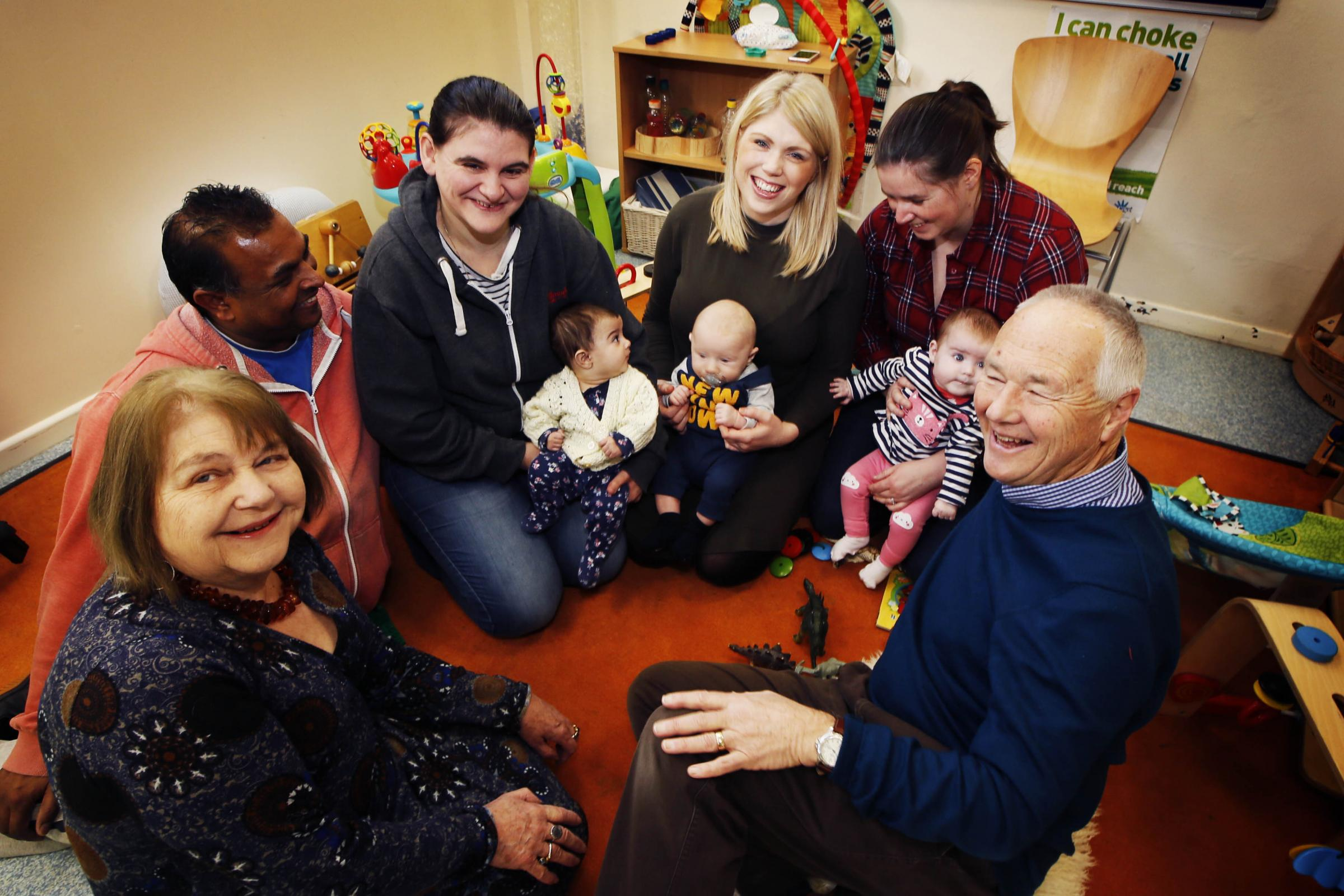 Manager and parents at Wheatley's Maple Tree children's centre. Left-to-right, Anne Purse, Andrew Lewis and Heidi Martin with Lola Lewis, Jess Webb with Jax Clarke, Lauren Newport with Mia Newport and Chris Sewell. Picture: Ed Nix