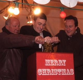 Jim Smith, Mark Wells and David Cameron switch on the lights