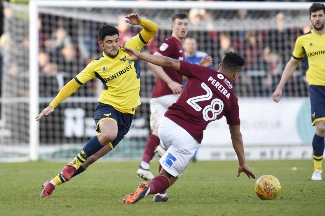 Alex Mowatt puts in a challenge during the second half at Northampton Town  Picture: David Fleming