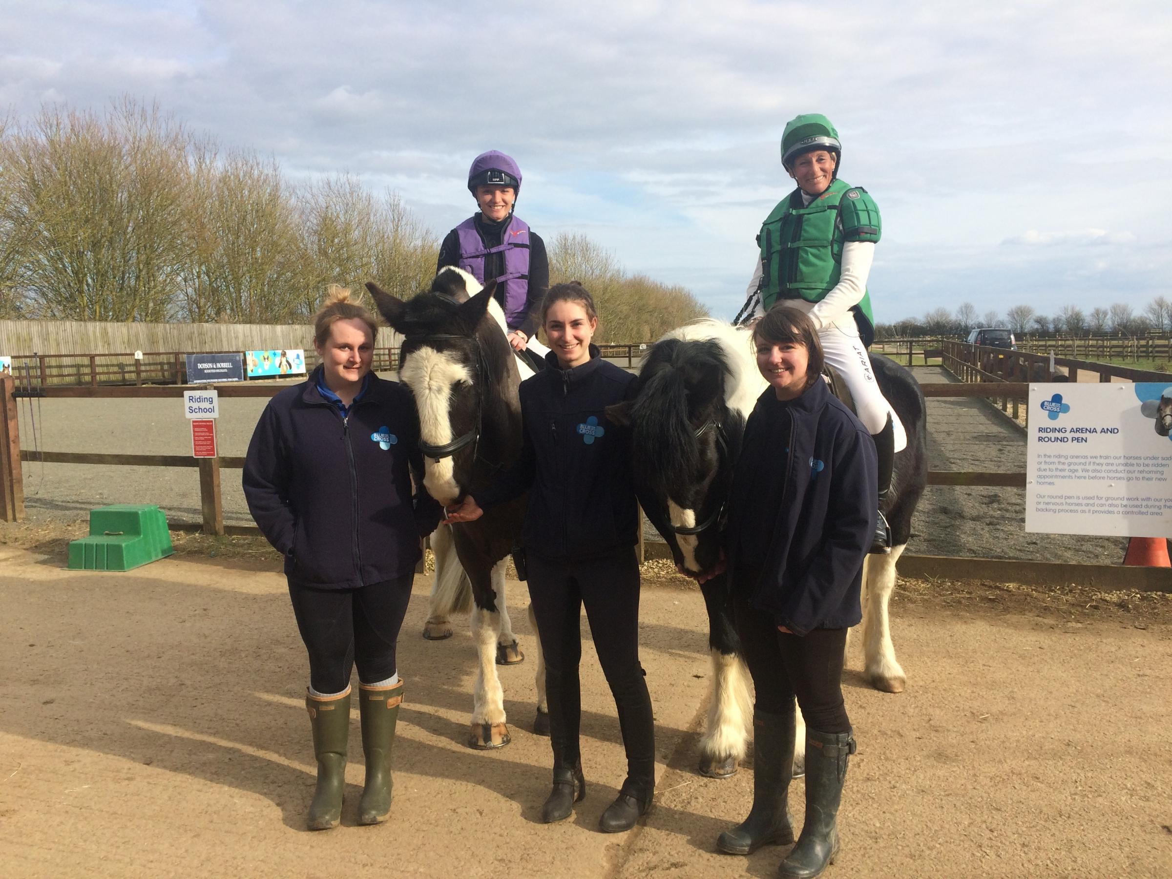 KINGS OF EVENTING: Veteran eventers and mother and daughter Mary and Emily King at the Blue Cross Burford rehoming centre with staff.