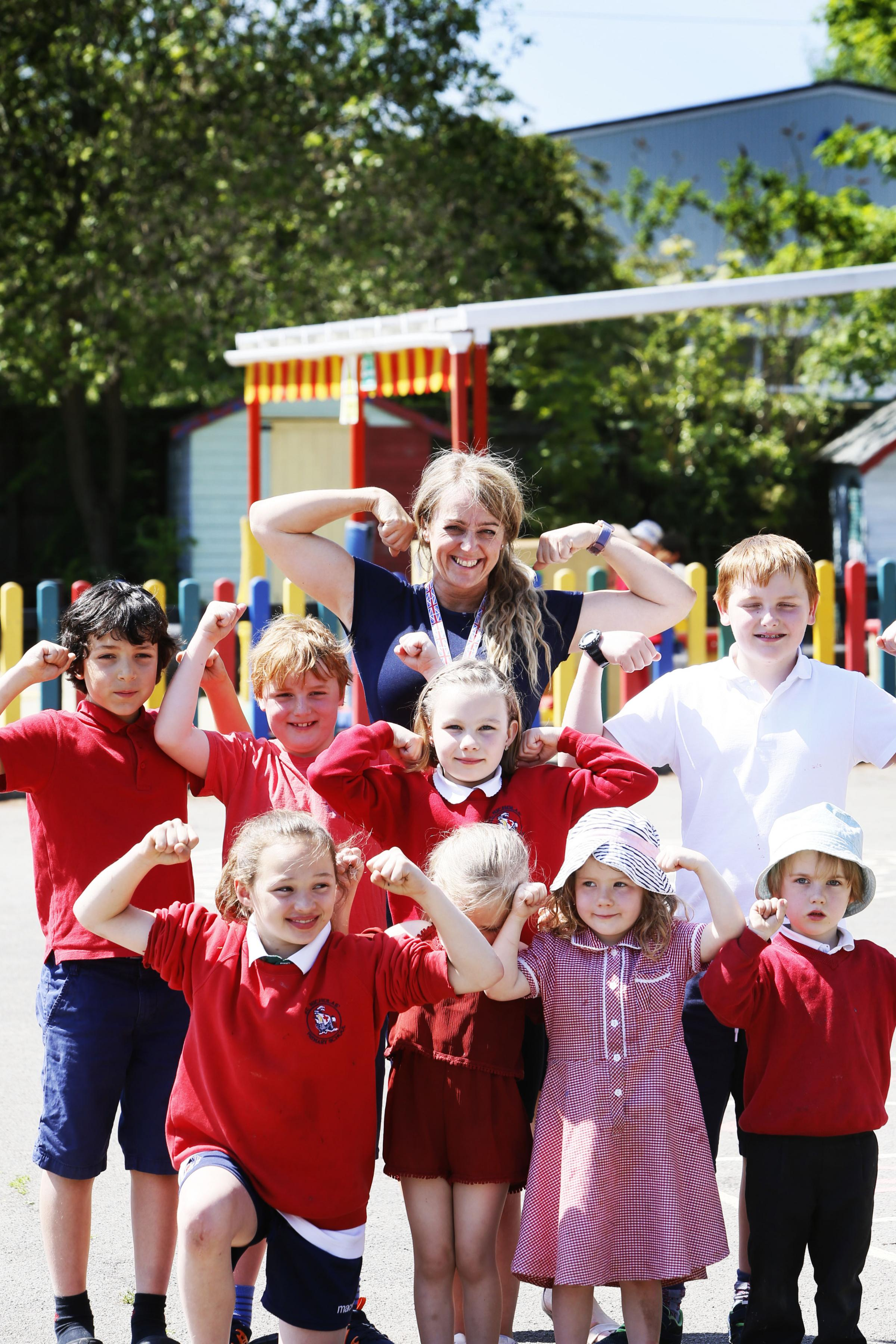 St Nicholas' Primary School headteacher Paula Phillips with pupils. Pic by Ed Nix
