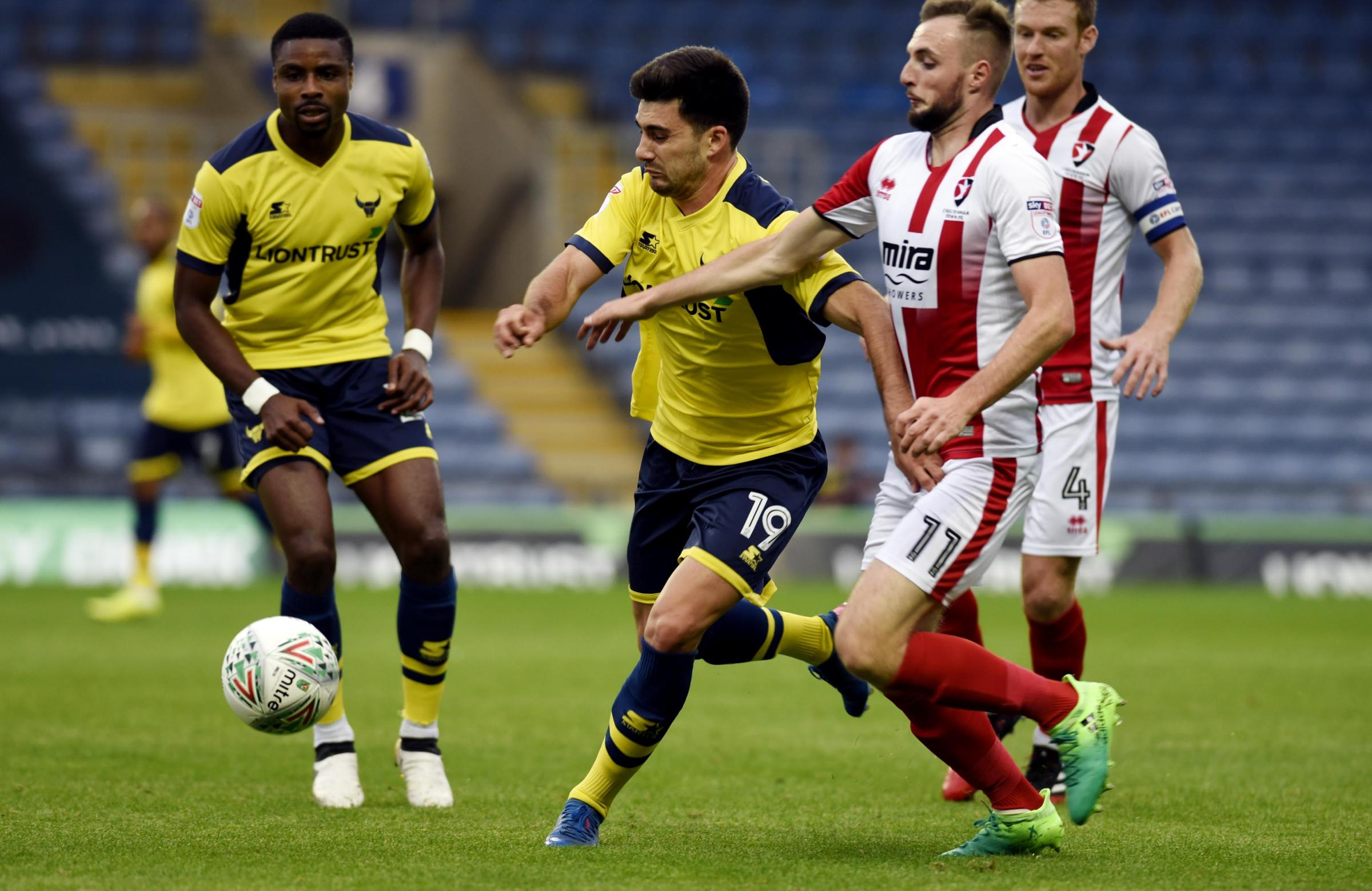 Xemi (No 19) was on target for Oxford United the last time they faced Cheltenham Town  Picture: David Fleming
