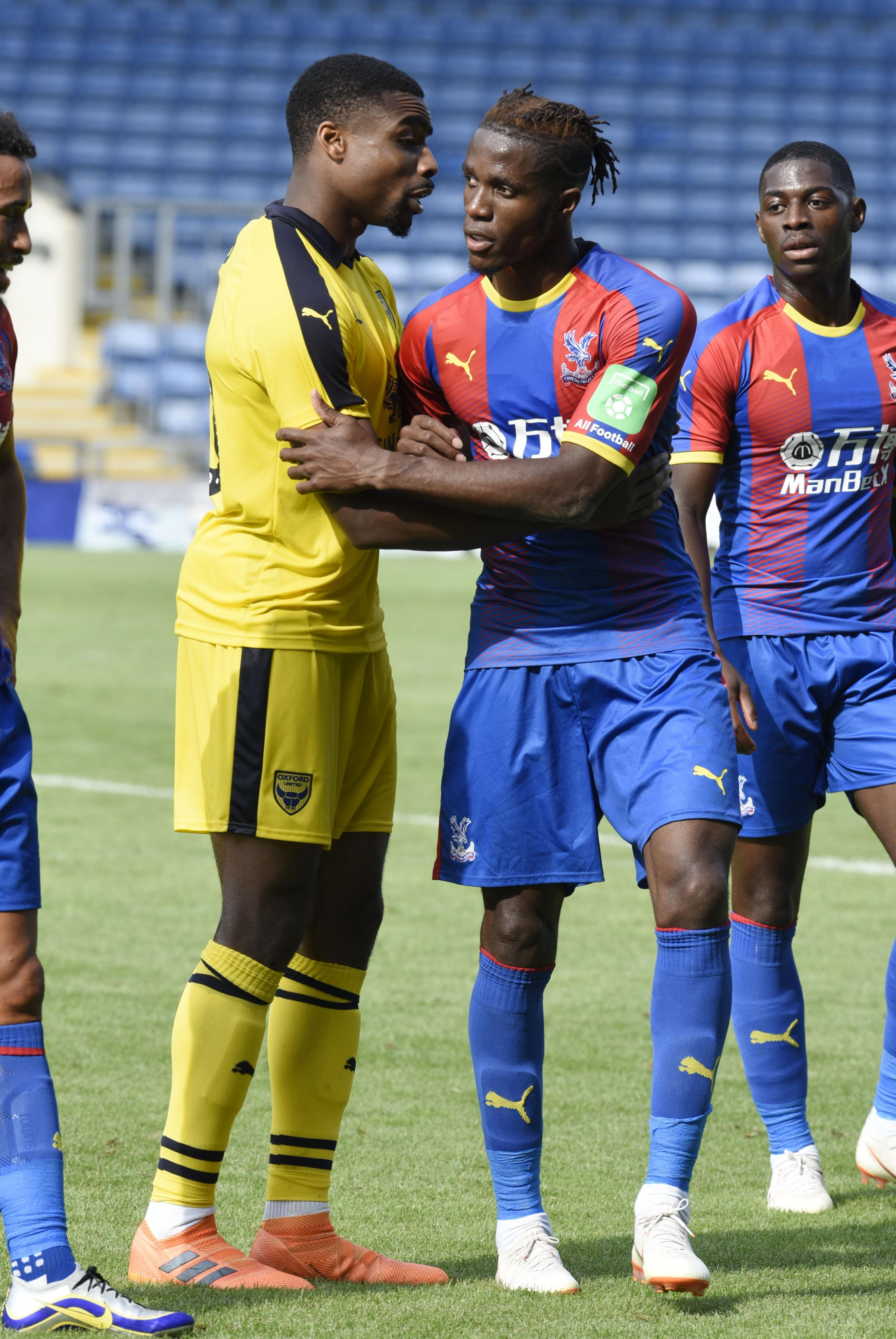 MEN OF THE MOMENT: Jon Obika and Wilfried Zaha shake hands at full-timePictures: David Fleming