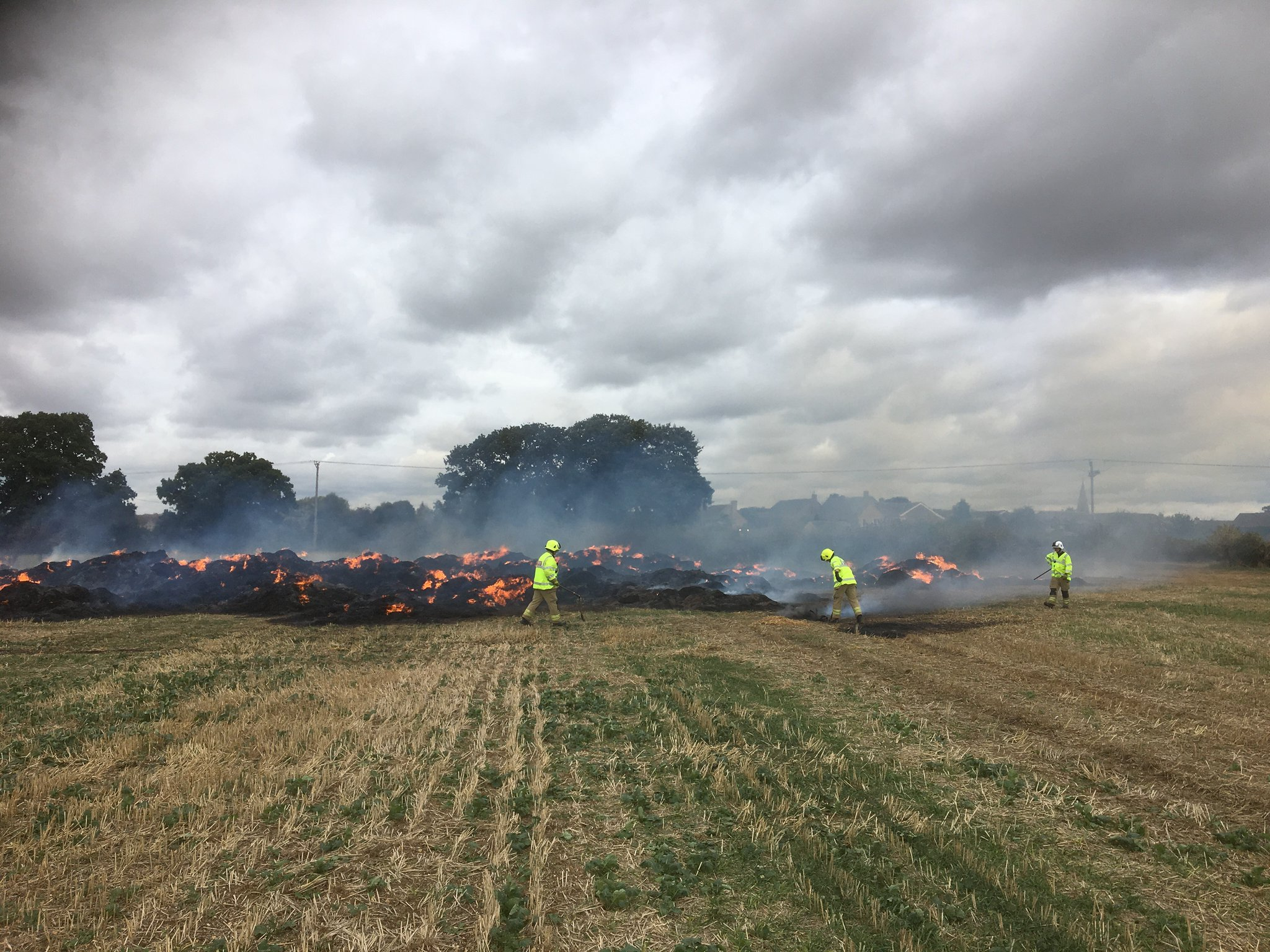 Villagers warned to close windows after straw bale fire causes plume of smoke