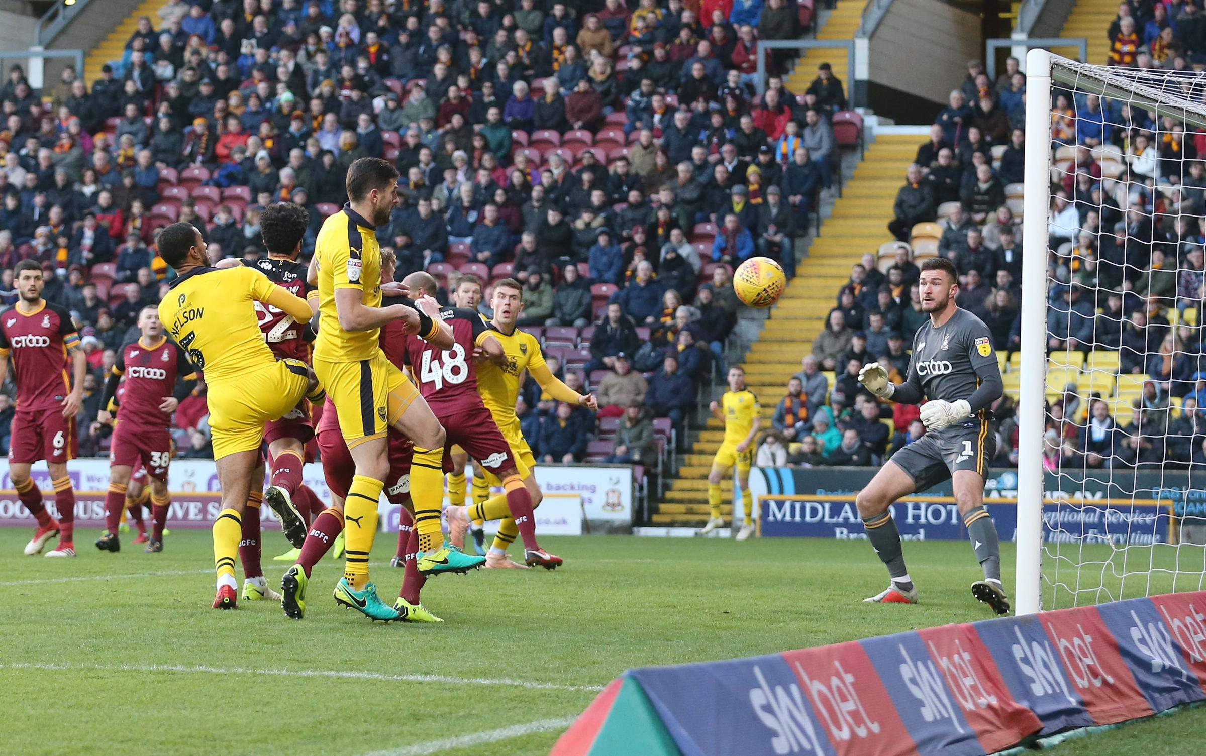 Curtis Nelson heads an early corner wide during Oxford United's 2-0 defeat at Bradford City Picture: Richard Parkes