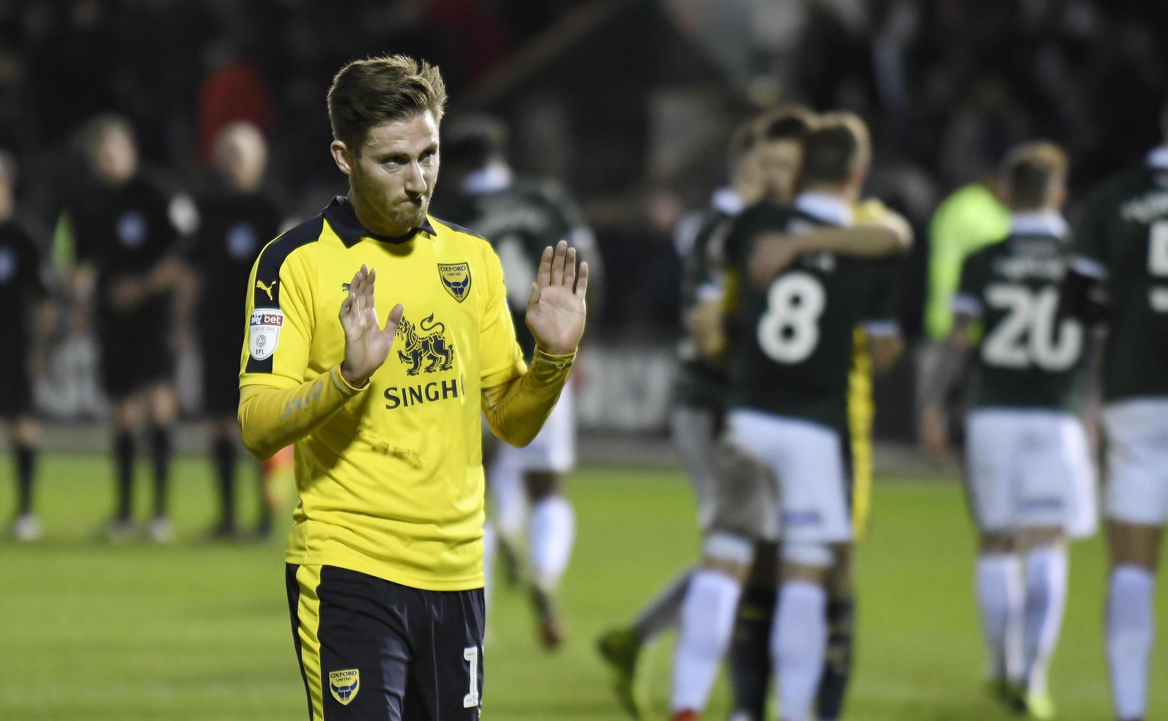 James Henry apologetically holds his hands up to Oxford United's travelling supporters after the 3-0 defeat at Plymouth Argyle Picture: David Fleming