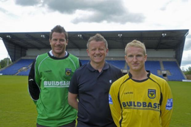 Witney Gazette: New signings Ryan Clarke (left) and Marcus Kelly with manager Chris Wilder