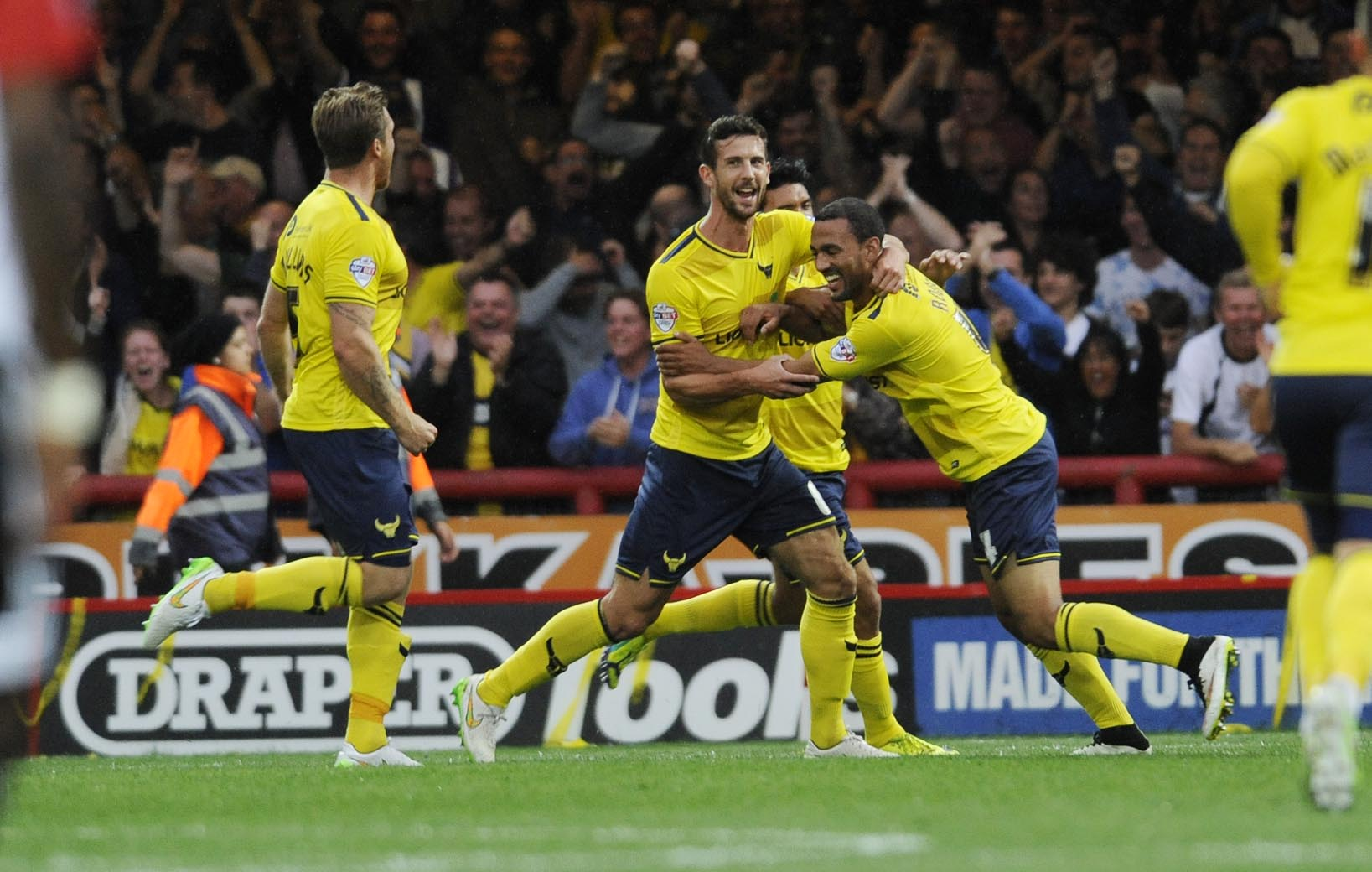 Kemar Roofe is congratulated after scoring a stunning long-range strike for Oxford United in their last trip to Brentford  Picture: David Fleming