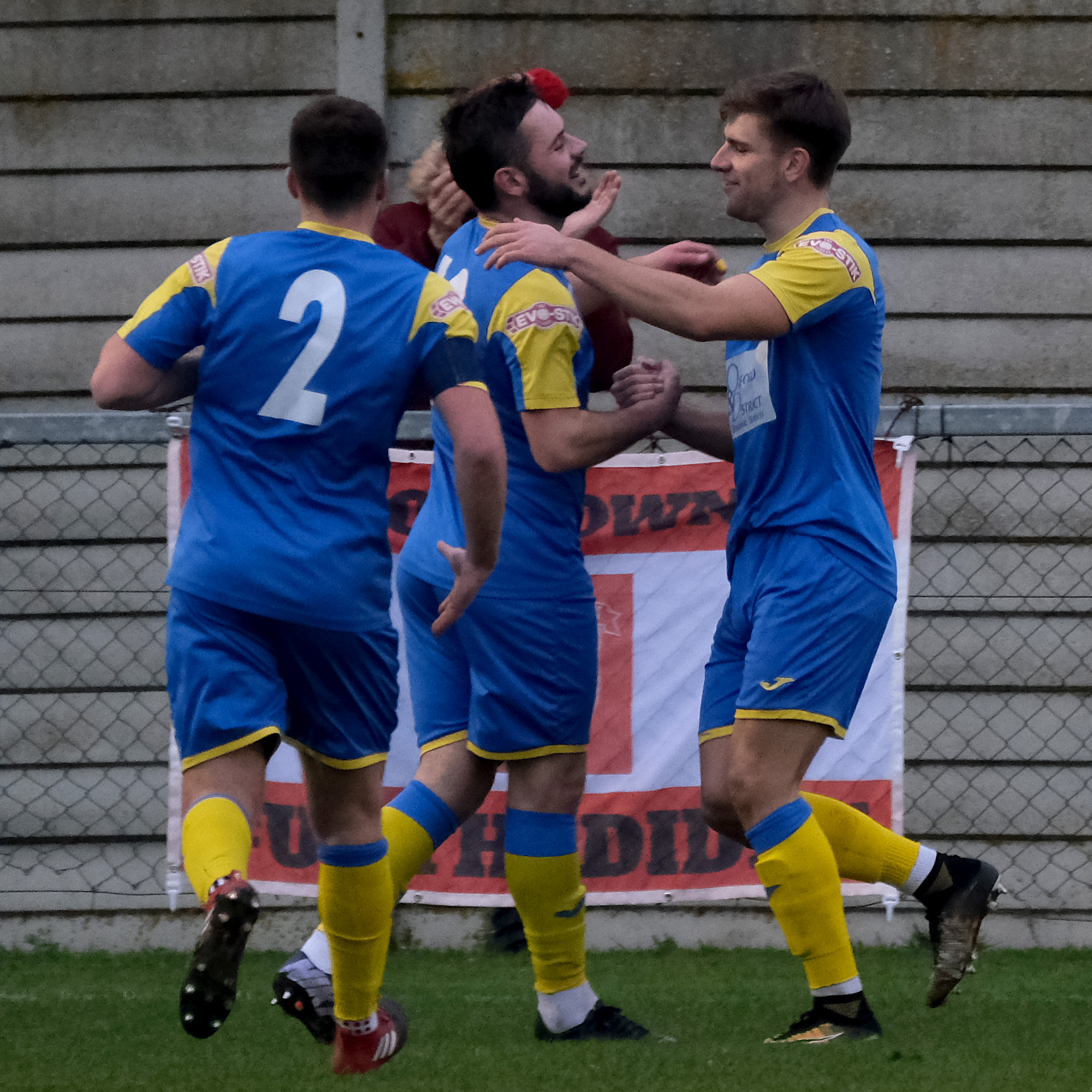 David Murphy is congratulated by Greg Hackett (right) after hitting what proved the winner in Didcot's 1-0 win over Thame. Below, Didcot's Luke Carnell wins this header at a cornerPictures: Ric Mellis
