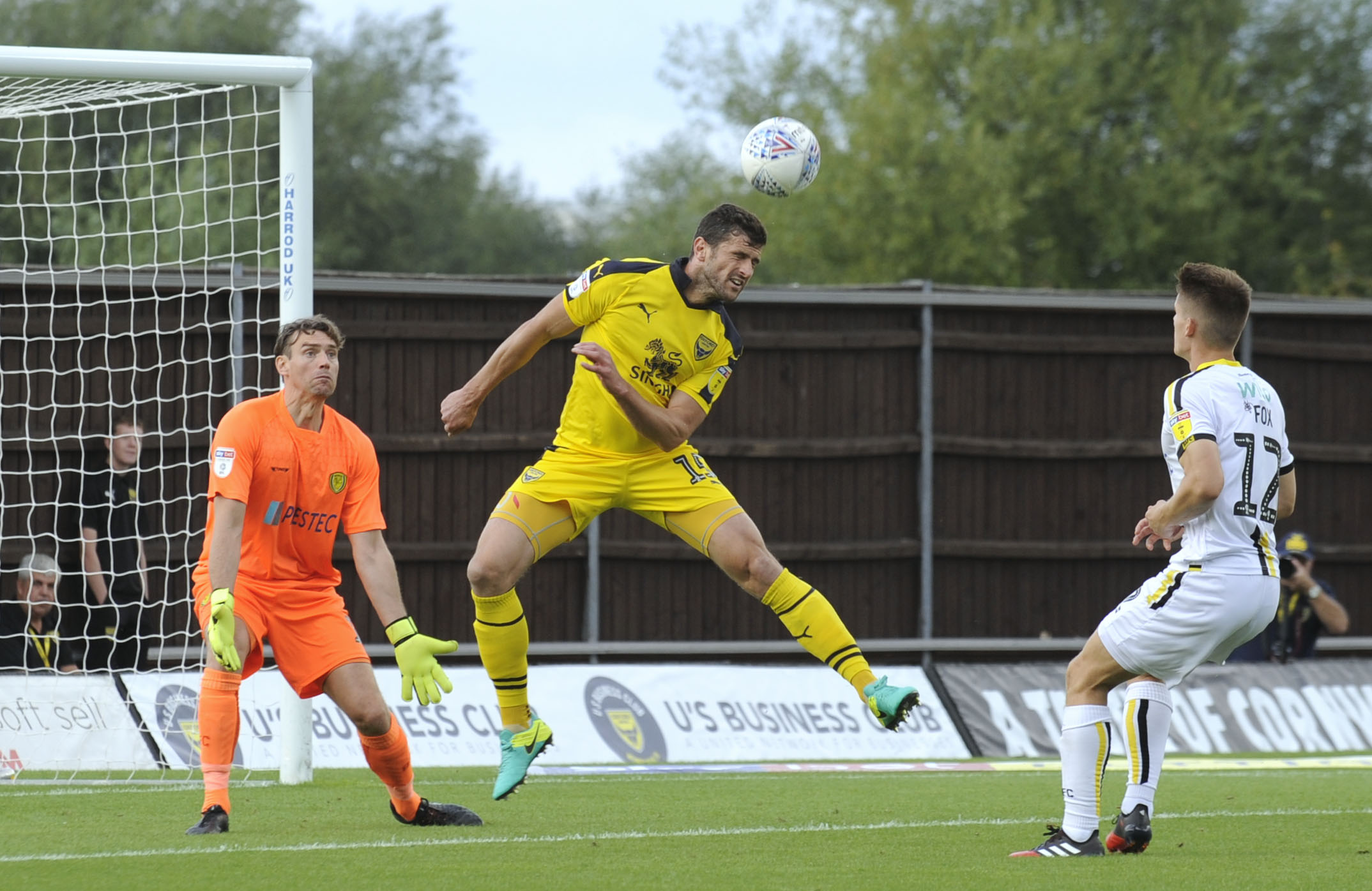 John Mousinho, a former Burton Albion player, heads in the opening goal of Oxford United's 3-1 win against the Brewers in August  Picture: David Fleming
