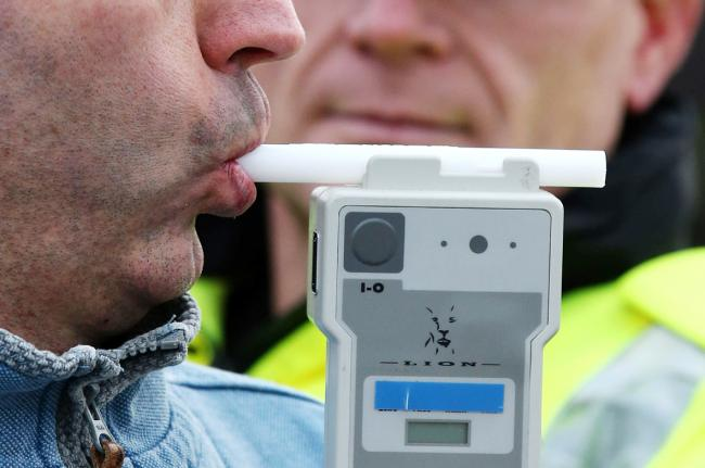 PICTURE POSED BY MODEL..File photo dated 03/12/14 of a man demonstrating breathalyser equipment as a stricter drink-drive limit has come into force in Scotland, prompting warnings that drivers in England who have one drink could be over the limit when the