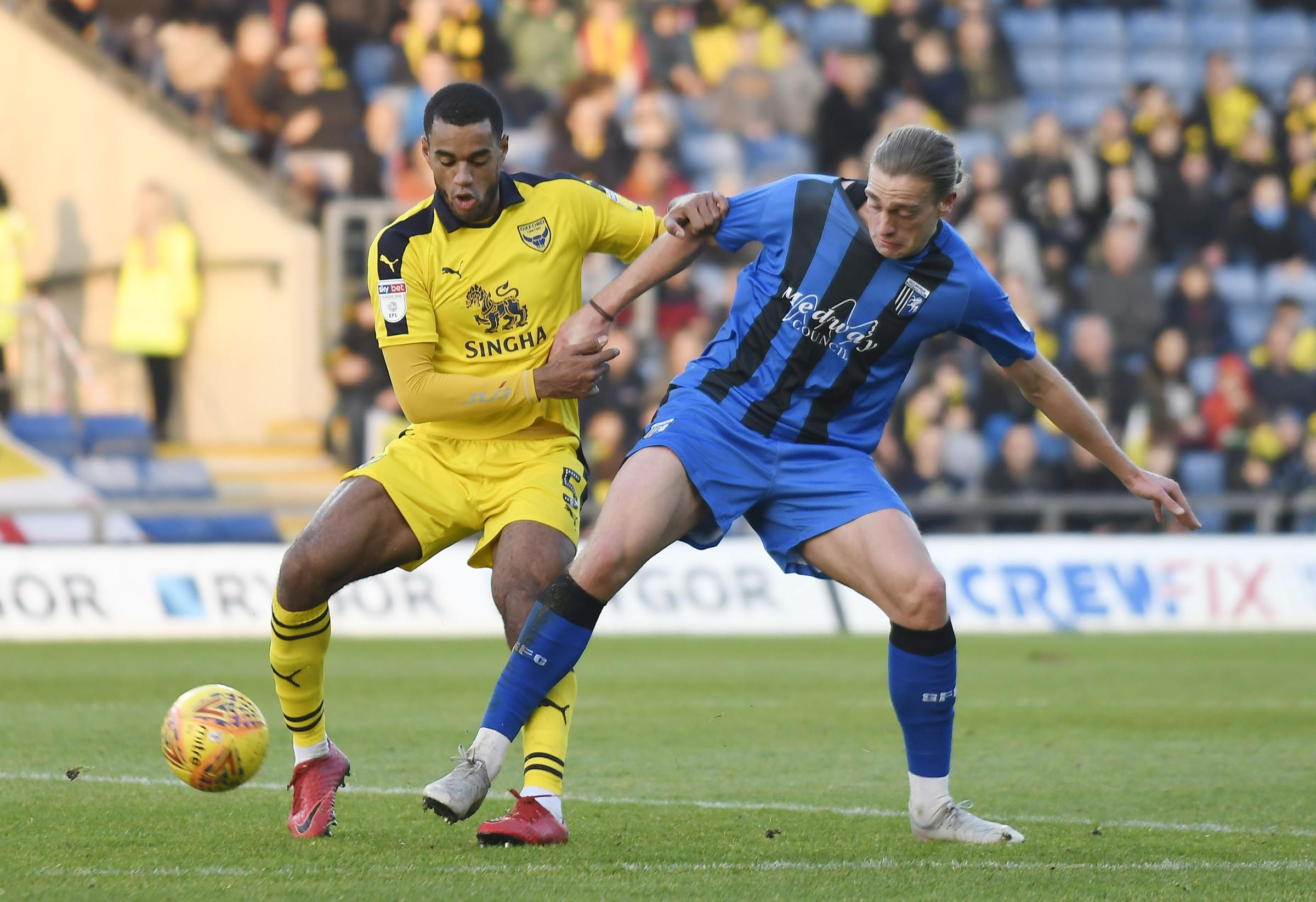 Curtis Nelson holds off Gillingham's Tom Eaves in Oxford United's 1-0 victory earlier this season  Picture: David Fleming