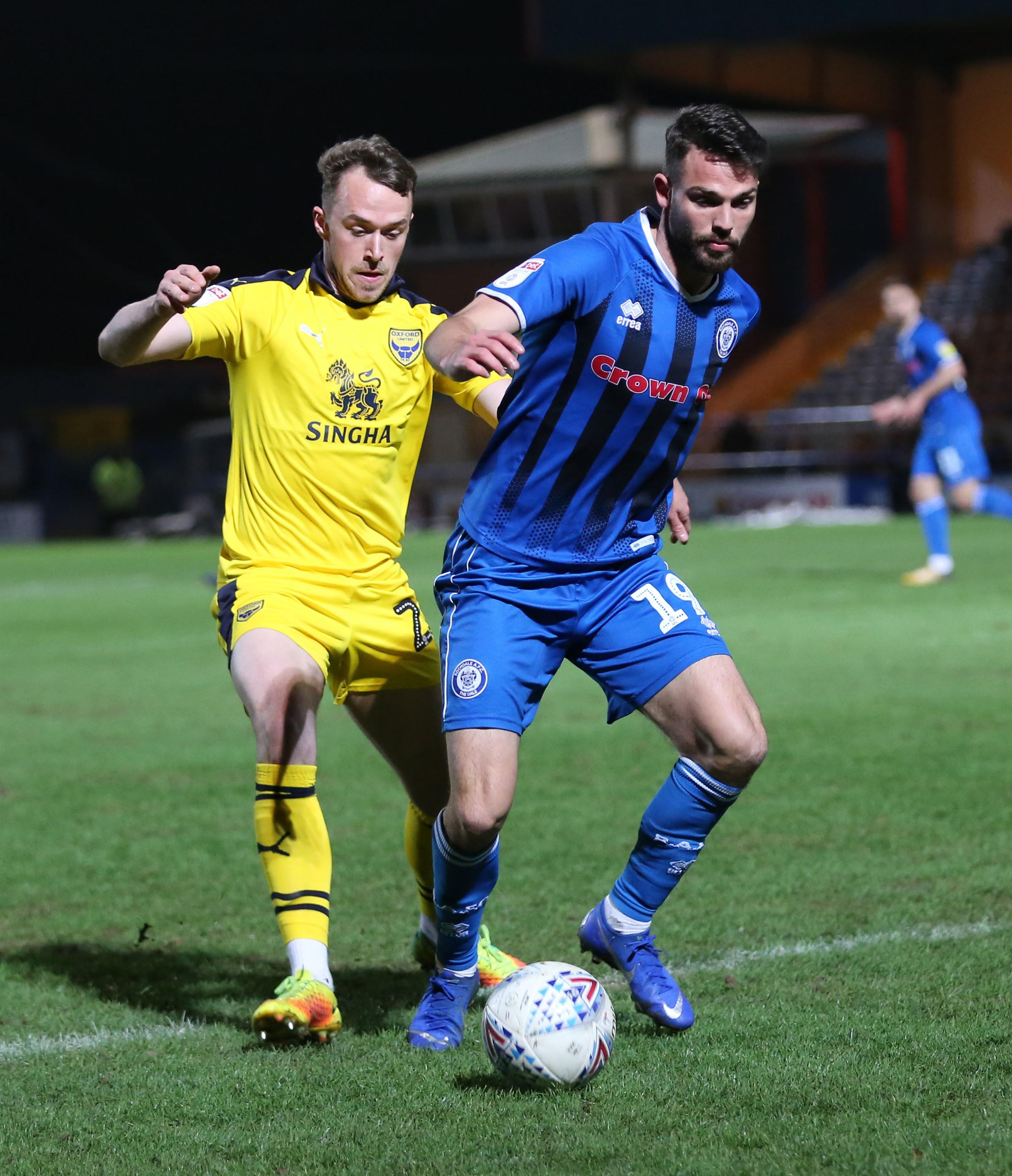 Sam Long puts in a challenge on Bradden Inman as he helped Oxford United to a clean sheet at Rochdale on Tuesday	 Picture: Richard Parkes
