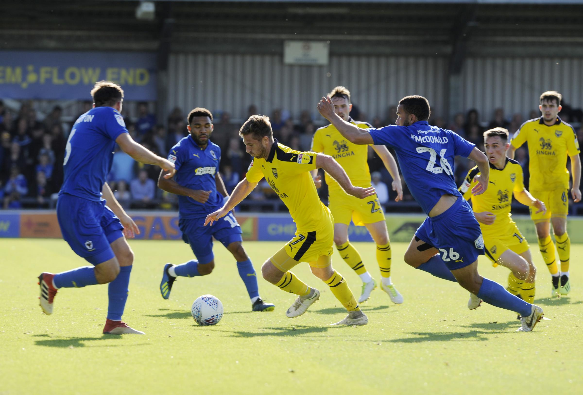 James Henry is surrounded by AFC Wimbledon players during Oxford United's 2-1 defeat in September  Picture: David Fleming