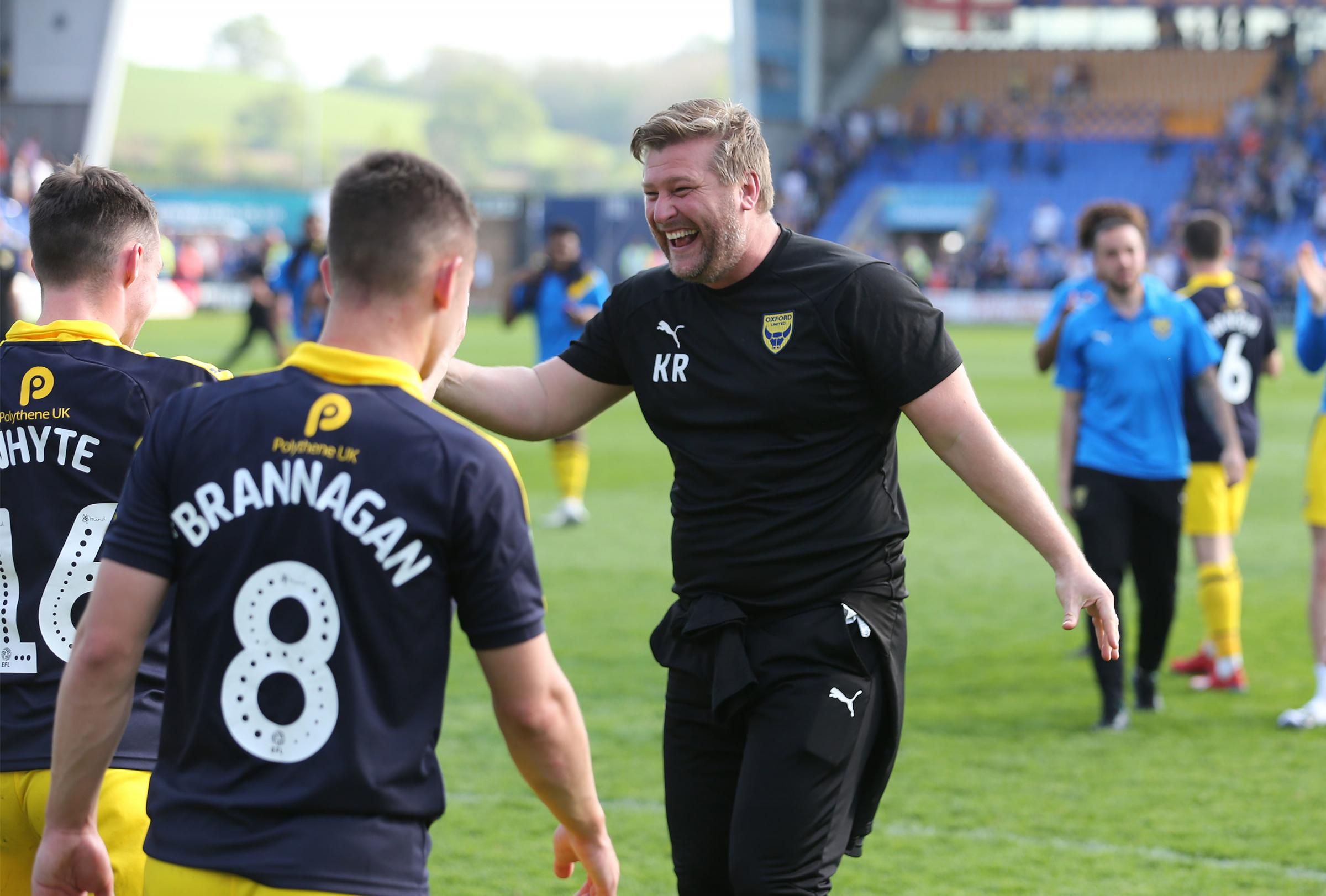 Karl Robinson congratulates Gavin Whyte on his hat trick  Picture: Richard Parkes
