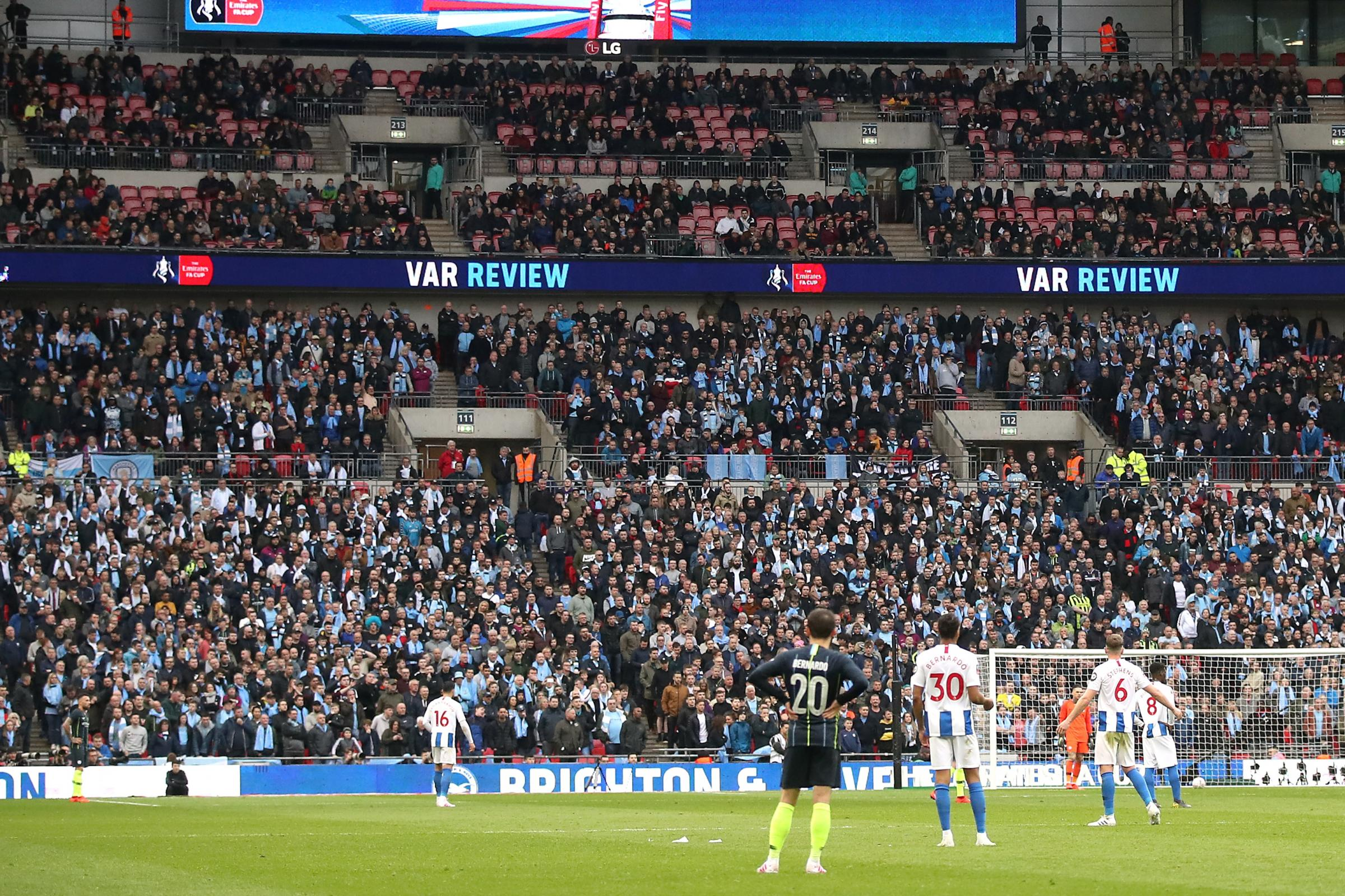 Empty seats visible at Wembley
