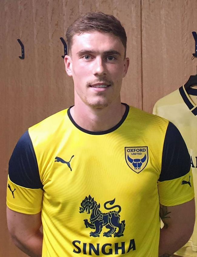 Josh Ruffels shows off Oxford United's new home kit for next season Picture: OUFC
